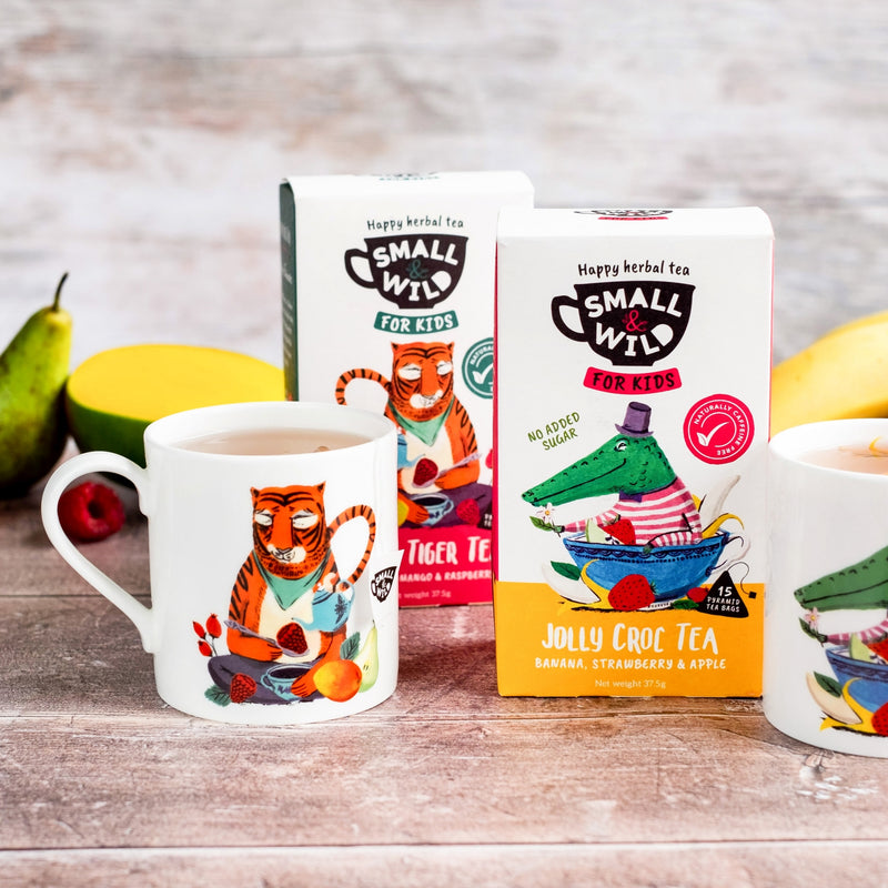 Jolly Croc and Merry Tiger kids mugs with boxes of tea and fruit