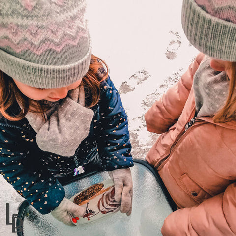 Two young girls handling their frozen treasures - ice sun catcher