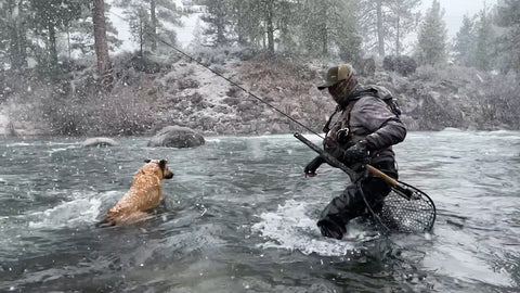 JEFF SASAKI AND HIS FOUR-LEGGED PAL, WINSTON THE AMAZING K9, BRAVE THE SNOW TO GET IN SOME CASTS ON THE TRUCKEE RIVER, PHOTO COURTESY MAVRK