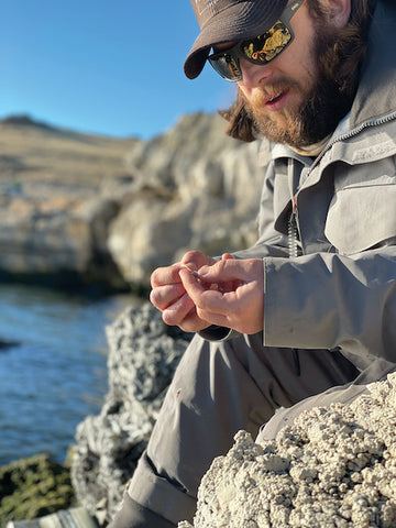 MILES ZIMMERMAN OF TROUT CREEK OUTFITTERS PREPARES A FLY FOR PYRAMID LAKE, PHOTO BY SCOTT KEITH, COURTESY TROUT CREEK OUTFITTERS