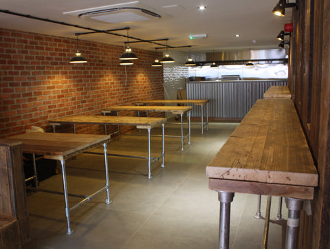 An industrial interior scheme with our reclaimed wood dining tables