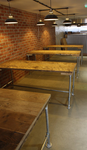 Our reclaimed wood and scaffol pole dining tables work well in the industrial scheme
