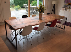 An industrial dining table with reclaimed wood and steel