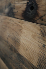 The natural warmth and character of a reclaimed wood dining table top