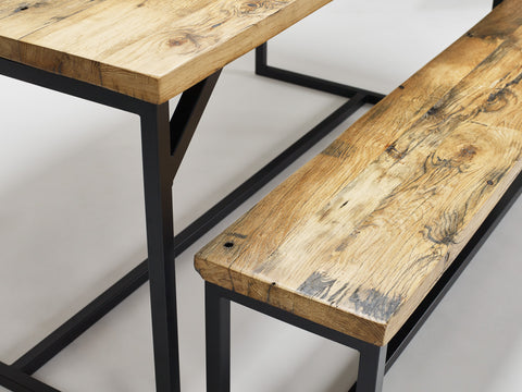 A close-up shot of our oak Deben table and bench, both in reclaimed wood and steel