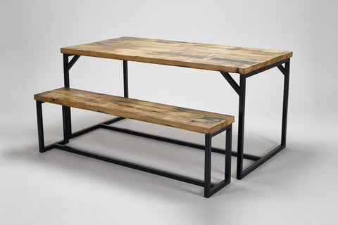 An angled view of our Deben table and bench both made from reclaimed oak combined with steel frames