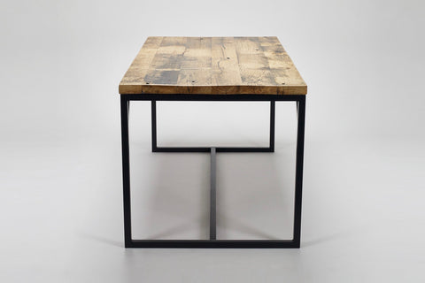 An end-on view of our Deben table in reclaimed wood, oak salvaged from French coal carriages