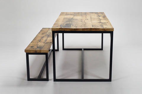 An end view of our Deben table and bench made from oak, reclaimed wood from French coal carriages