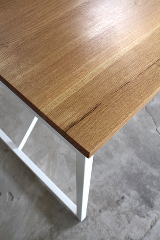 The Kanteen oak dining table combines wood with a steel frame