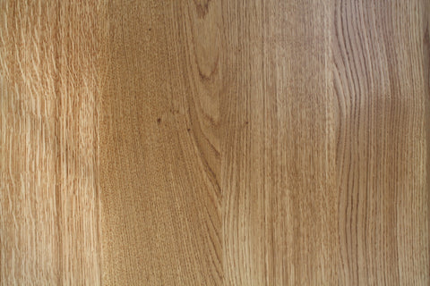 The natural warmth of an oak dining table top