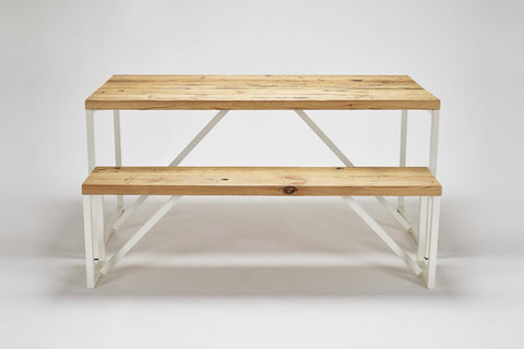A side view of our Kanteen table and bench made from reclaimed wood with steel supports