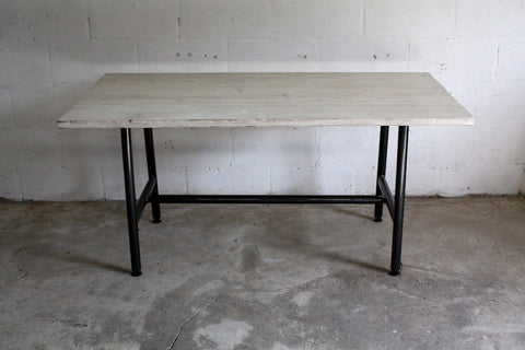 Our Kenton dining table made from reclaimed wood and a steel tube frame