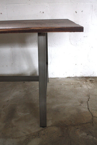 The warmth of an oak table top with the cool edge of industrial steel