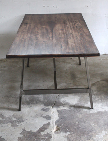 A farmhouse dining table for the twenty first century in character oak and steel