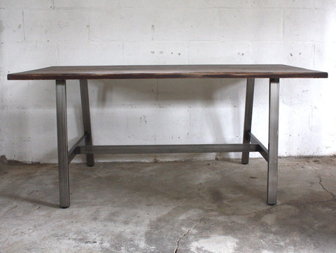 The Lily dining table mixes the style of industrial furniture with a rustic edge