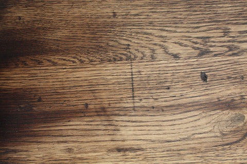 We scar and age the character oak to give our tops the look of a reclaimed wood table