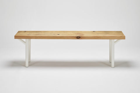 Our Trammel bench has a reclaimed wood top in pine and tube steel supports