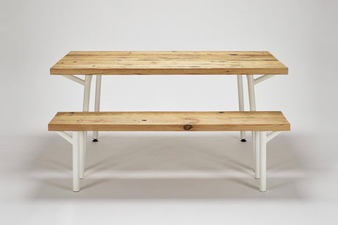 The Trammel bench with its accompanying Trammel dining table, both in reclaimed wood with tube steel supports