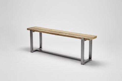 Seen from an angle, the Uff bench marries together reclaimed wood and a robust steel frame