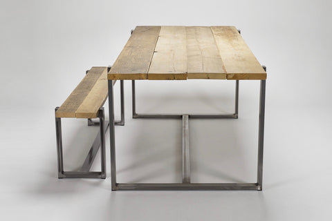 The end view of the Uff bench and table show the rustic character of their reclaimed wood tops