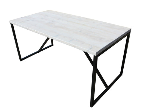 A Kanteen dining table with its reclaimed wood top finished with lime wax and steel supports with storm grey powder coat