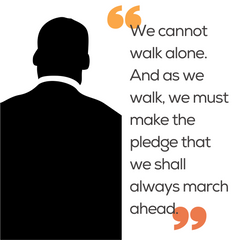 """Silhouette of Dr. Martin Luther King, Jr. with the quote"""" We cannot walk alone. and as we walk, we must make the pledge that we shall always march ahead."""""""