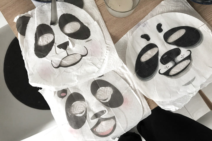 Panda face masks on the table
