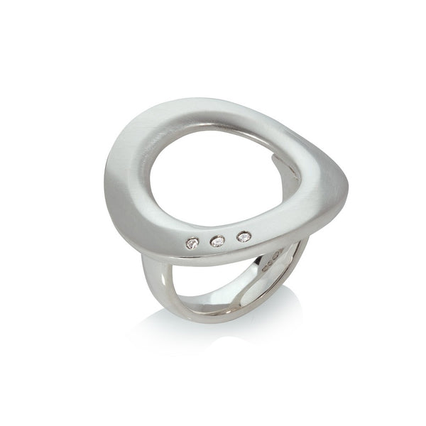 A Sterling Silver Ring as a large 'Halo' set with 3 small Diamonds, designed by Sabine König.