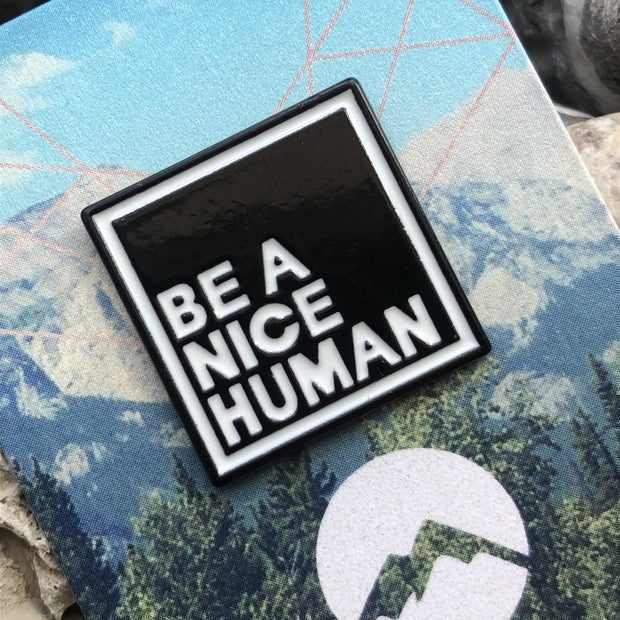Be A Nice Human Enamelled Pin -  Wonderland -  marketsquare-collective.myshopify.com
