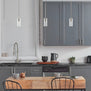 Brushed nickel pendant light in kitchen