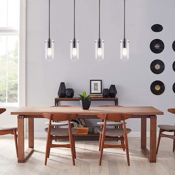 Black Kitchen island pendant light hanging in the dining room