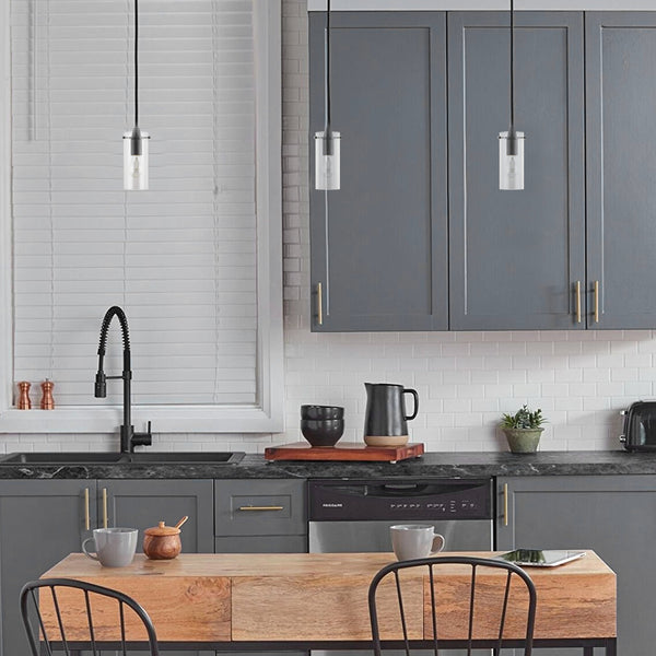 Black pendant light in kitchen