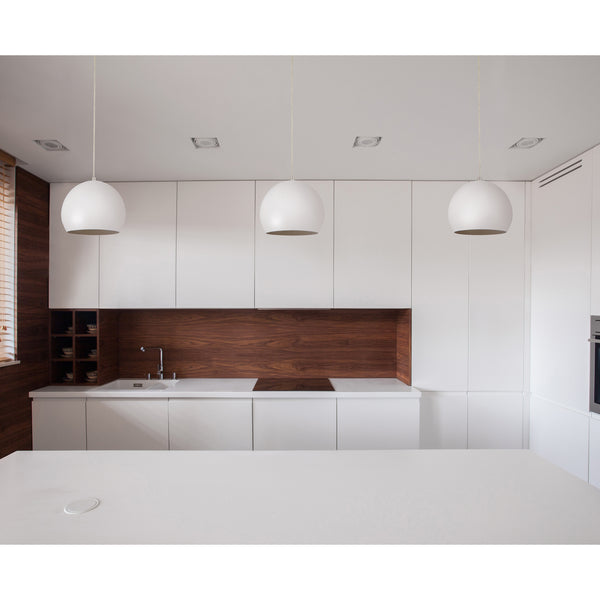 Beautiful white pendant light with globe shade in a kitchen
