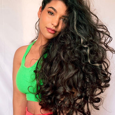 Woman with long curled hair
