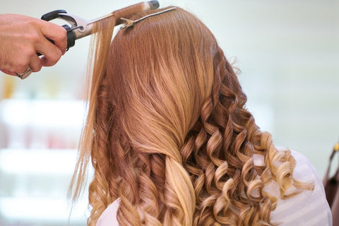 Woman's hair getting curled