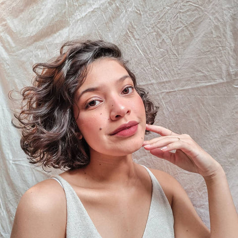 Woman with short curled hair