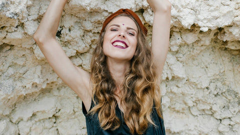 Smiling woman with blowout brush styled hair