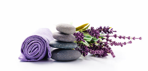 Lavender with purple towel and stones
