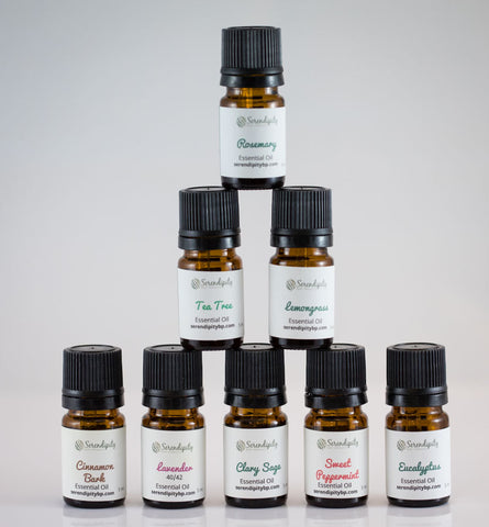 Essential oil bottles stacked in a pyramid