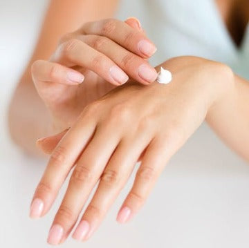Woman's hands with lotion