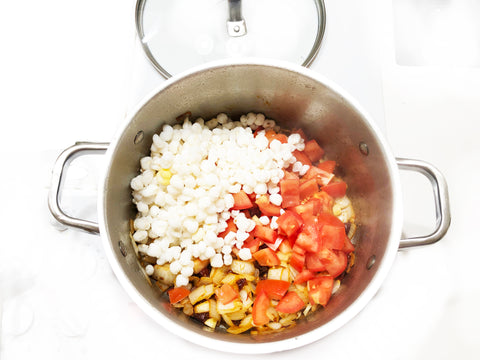 add in hominy tomatoes and garlic to chantal stripes 6 qt stock pot
