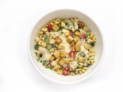 add all ingredients for caesar chicken pasta salad to bowl to mix before adding back to 3. clad 5 quart sauteuse