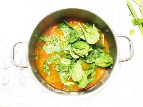 add spinach and cilantro to posole soup in 6 quart stripes stock pot