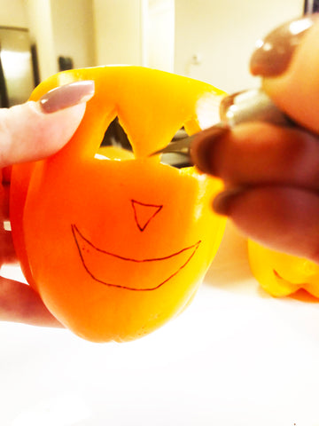 cutting face out of jack o lantern pepper
