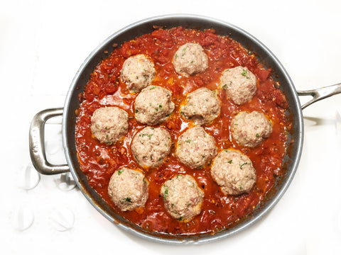adding meatballs to marinara sauce in 12.5 inch coated induction 21 frypan for chicken parmesan