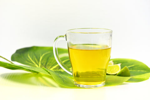 Hot green tea cup with lime