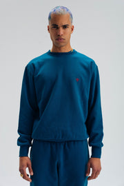 Core Crewneck de couleur bleu petrole