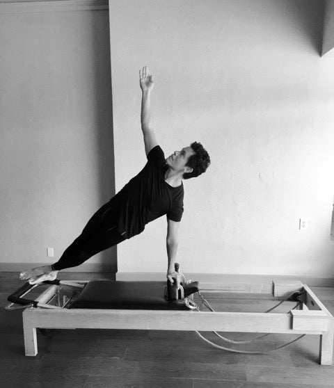 Gratz Gallery | Saul Choza performing the One Arm Twist on the Universal Reformer