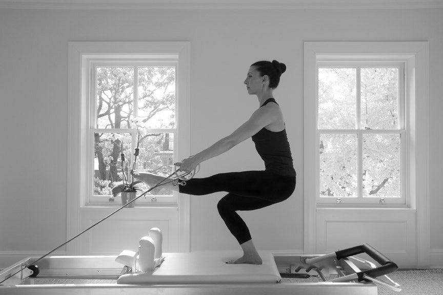 Gratz Gallery | Ilaria Cavagna performing the Russian Squats on the Universal Reformer