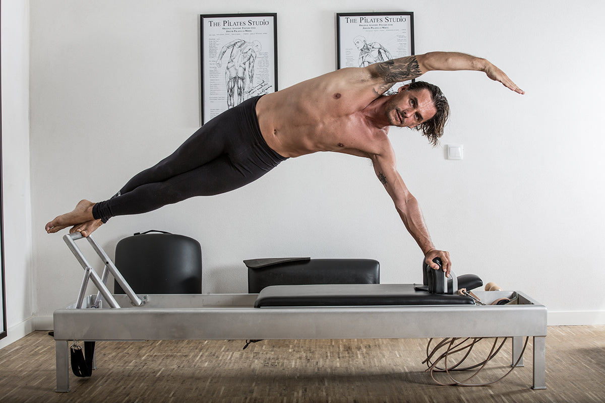 Gratz Gallery | Miguel Silva doing the Snake & Twist - Side Band Variation on the on the Archive Reformer